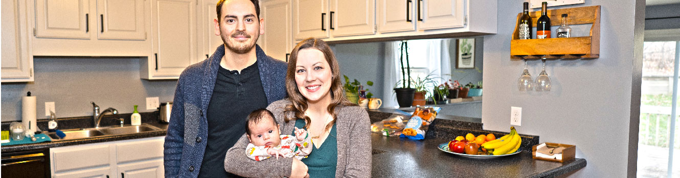 Couple with baby in new kitchen
